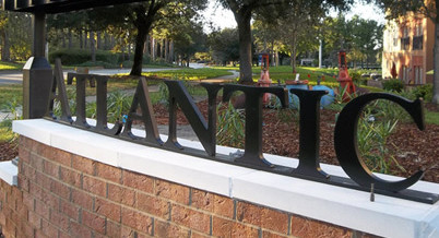 Monument sign comprised of a brick base, aluminum letters, and aluminum accents.